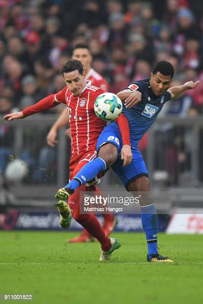 Sebastian Rudy of Bayern Muenchen fights for the ball with Serge Gnabry of Hoffenheim during the Bundesliga match between FC Bayern Muenchen and TSG...