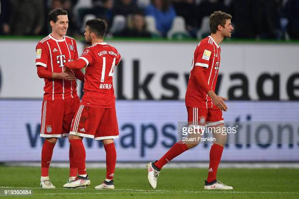 Sebastian Rudy of Bayern Muenchen Juan Bernat of Bayern Muenchen and Thomas Mueller of Bayern Muenchen celebrate after the Bundesliga match between...