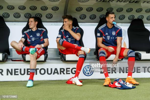 Sebastian Rudy of Bayern Muenchen Leon Goretzka of Bayern Muenchen and Sandro Wagner of Bayern Muenchen sit on the bench prior to the DFL Supercup...