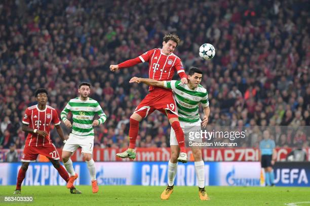 Sebastian Rudy of FC Bayern Muenchen and Tom Rogic of Celtic FC compete for the ball during the UEFA Champions League group B match between Bayern...