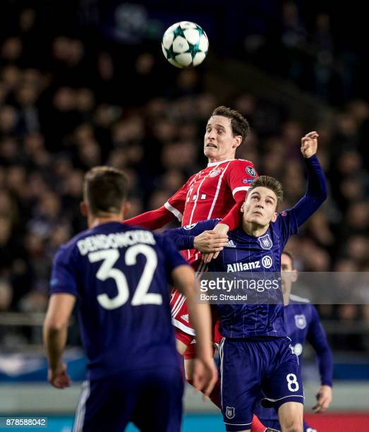 Sebastian Rudy of FC Bayern Muenchen jumps for a header with Pieter Gerkens of Anderlecht during the UEFA Champions League group B match between RSC...