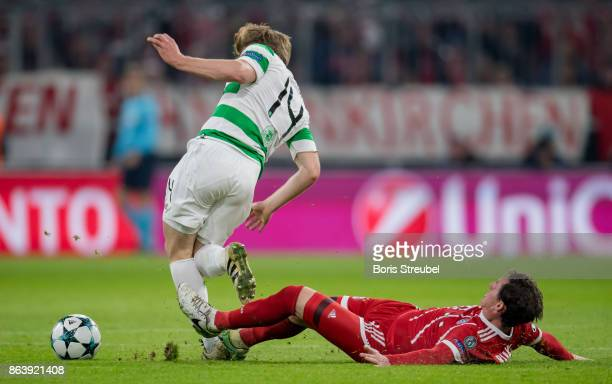 Sebastian Rudy of FC Bayern Muenchen tackles Stuart Armstrong of Celtic FC during the UEFA Champions League group B match between Bayern Muenchen and...