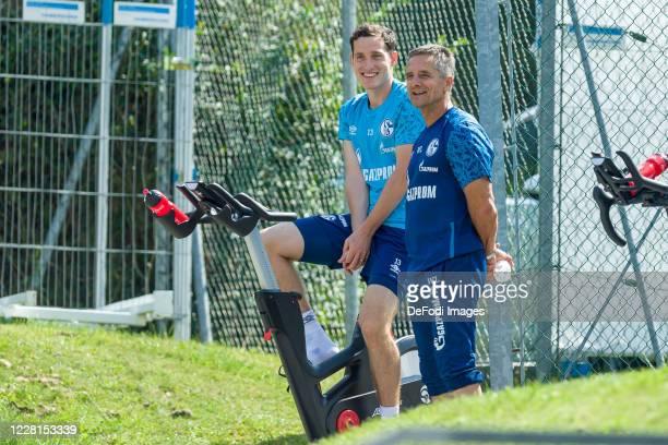 Sebastian Rudy of FC Schalke 04 and Athletikhead coach Werner Leuthard of FC Schalke 04 smiles during the FC Schalke 04 Training Camp on August 22,...