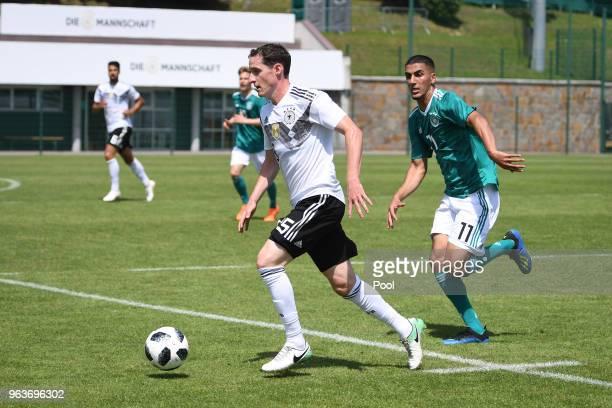 Sebastian Rudy of Germany and Aymen Barkok of Germany U20's during a Germany v Germany U20 test match at German national team training camp on May 30...