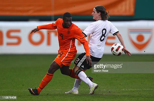 Sebastian Rudy of Germany and Genero Zeefuik of Netherlands battle for the ball during the U21 international friendly match between Germany and...