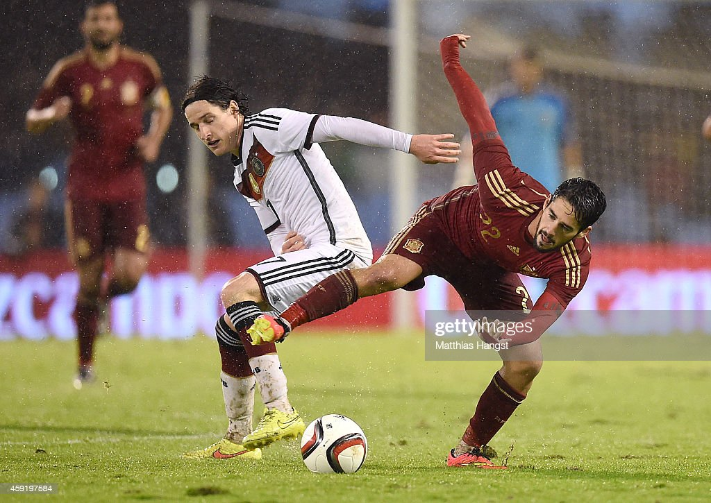 Sebastian Rudy (L) of Germany and Isco (R) of Spain compete for the ball during the International Friendly match between Spain and Germany at Estadio Balaidos on November 18, 2014 in Vigo, Spain.