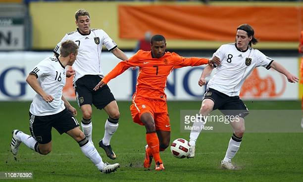 Sebastian Rudy of Germany and Luciano Narsingh of Netherlands battle for the ball during the U21 international friendly match between Germany and...