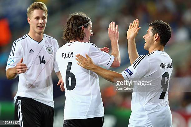 Sebastian Rudy of Germany celebrates his team's second goal with team mates Sebastian Polter and Kevin Volland during the UEFA European U21...