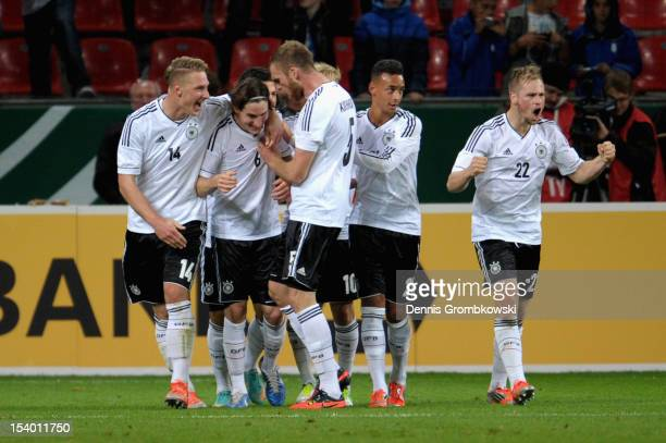 Sebastian Rudy of Germany celebrates with teammates after scoring his team's first goal during the Under 21 European Championship Play Off match...
