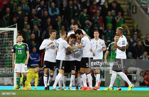 Sebastian Rudy of Germany is mobbed by team mates after scoring during the FIFA 2018 World Cup Qualifier between Northern Ireland and Germany at...