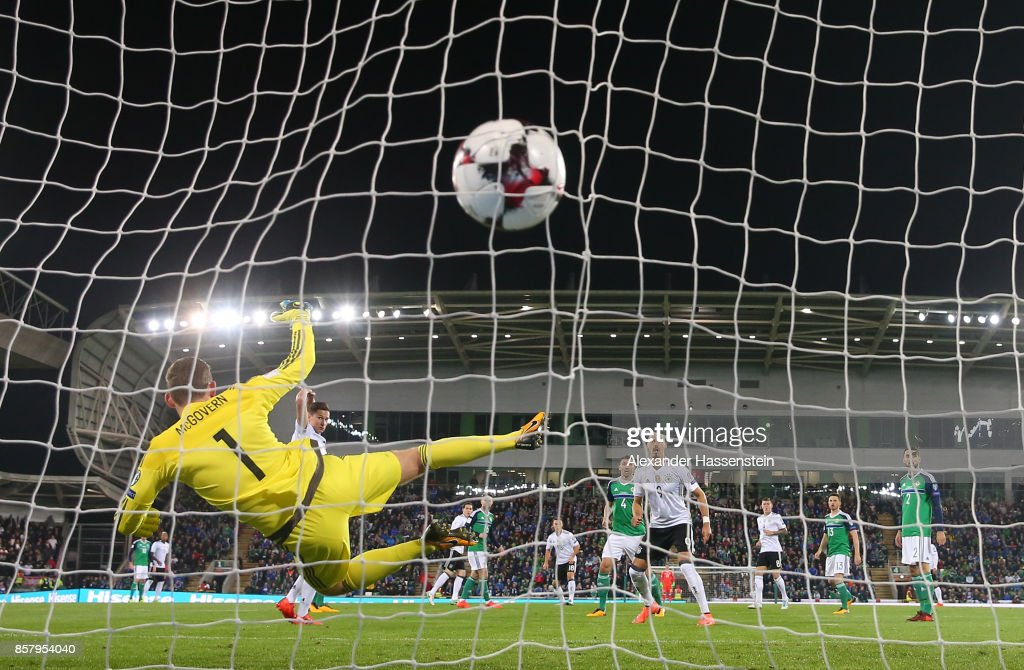 Sebastian Rudy of Germany shoots past Michael McGovern of Northern Ireland to score his goal during the FIFA 2018 World Cup Qualifier between Northern Ireland and Germany at Windsor Park on October 5, 2017 in Belfast, Northern Ireland.
