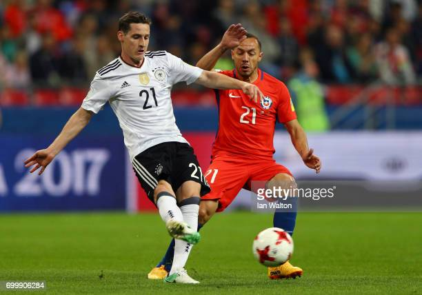 Sebastian Rudy of Germanyis put under pressure from Marcelo Diaz of Chile during the FIFA Confederations Cup Russia 2017 Group B match between...