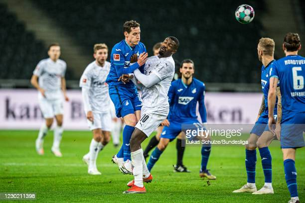 Sebastian Rudy of Hoffenheim and Marcus Thuram of Mönchengladbach in action during the Bundesliga match between Borussia Mönchengladbach and TSG...