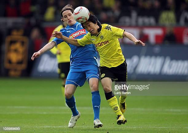 Sebastian Rudy of Hoffenheim challenges Shinji Kagawa during the Bundesliga match between Borussia Dortmund and 1899 Hoffenheim at Signal Iduna Park...