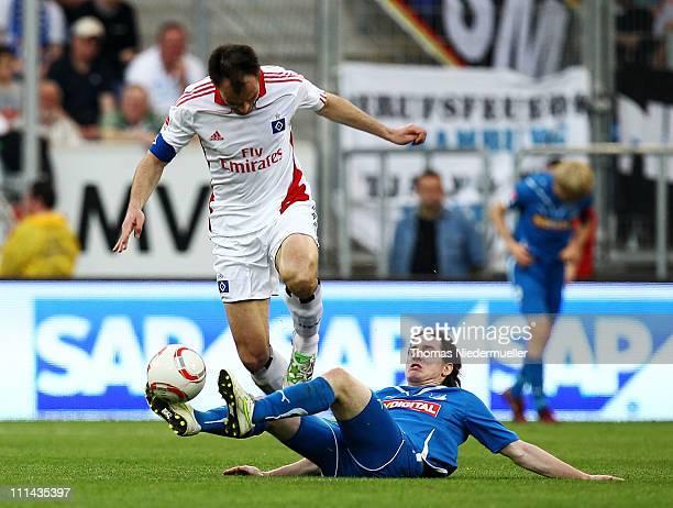 Sebastian Rudy of Hoffenheim fights for the ball with Heiko Westermann of Hamburg during the Bundesliga match between TSG 1899 Hoffenheim and...