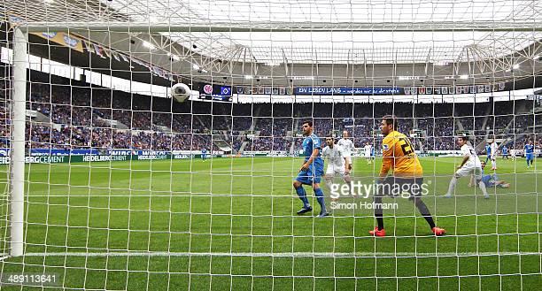 Sebastian Rudy of Hoffenheim scores his team's first goal against goalkeeper Daniel Davari of Braunschweig during the Bundesliga match between 1899...