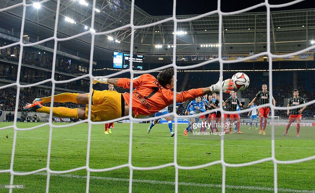 Sebastian Rudy of Hoffenheim scores his team's second goal past goalkeeper Roman Buerki of Freiburg during the Bundesliga match between TSG 1899 Hoffenheim and SC Freiburg at Wirsol Rhein-Neckar-Arena on September 23, 2014 in Sinsheim, Germany.