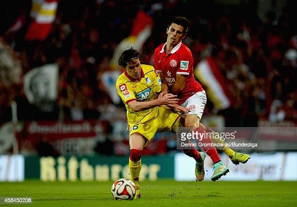 Sebastian Rudy of TSG 1899 Hoffenheim and Jonas Hofmann of 1 FSV Mainz 05 battle for the ball during the Bundesliga match between 1 FSV Mainz 05 and...