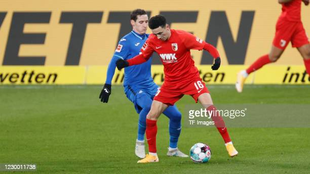 Sebastian Rudy of TSG 1899 Hoffenheim and Ruben Vargas of FC Augsburg during the Bundesliga match between TSG Hoffenheim and FC Augsburg at...