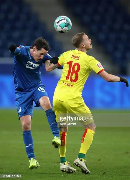 Sebastian Rudy of TSG 1899 Hoffenheim challenges for the high ball with Ondrej Duda of 1. FC Koln during the Bundesliga match between TSG Hoffenheim...