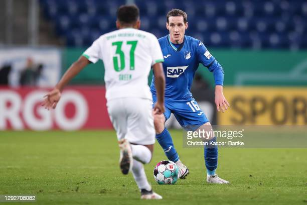 Sebastian Rudy of TSG 1899 Hoffenheim challenges Julian Green of SpVgg Greuther Fürth during the DFB Cup second round match between TSG Hoffenheim...