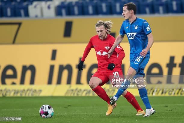 Sebastian Rudy of TSG 1899 Hoffenheim is challenged by Emil Forsberg of RB Leipzig during the Bundesliga match between TSG Hoffenheim and RB Leipzig...