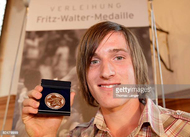 Sebastian Rudy of VFB Stuttgart poses with the silver medal for the second best U18 player 2007/2008 during the Fritz Walter Medal Award 2008 at the...