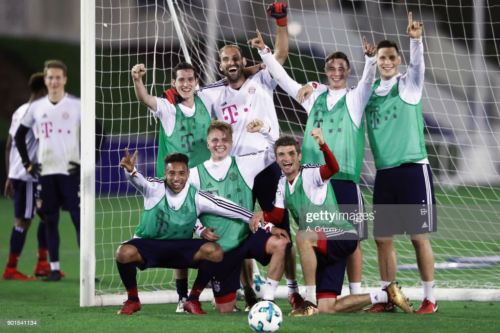 Sebastian Rudy, Tom Starke, Niklas Dorsch, Niklas Suele (back, L-R), Corentin Tolisso, Felix Goetze and Thomas Mueller (front, L-R) pose for a photo after winning a training match during a training session on day 4 of the FC Bayern Muenchen training camp at ASPIRE Academy for Sports Excellence on January 5, 2018 in Doha, Qatar.
