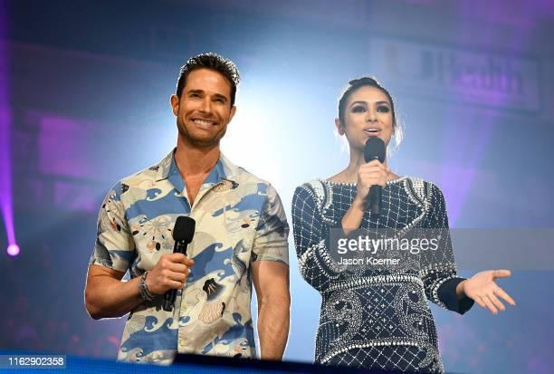Sebastian Ruli and Renata Notini speak on stage during Premios Juventud 2019 at Watsco Center on July 18 2019 in Coral Gables Florida