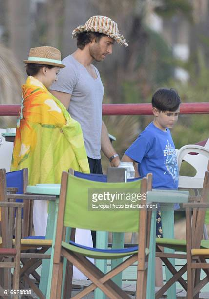 Part of this image has been pixellated to obscure the identity of the child Sebastian Rulli and Angelique Boyer are seen on October 3 2016 in...