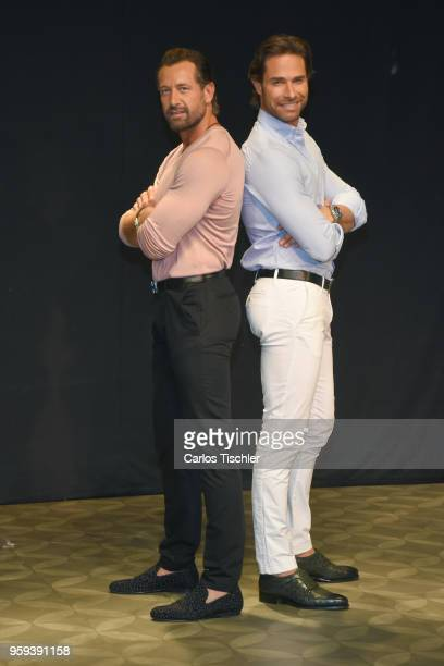 Sebastian Rulli and Gabriel Soto pose for photos during a press conference to promote Una Pareja de Tres at 11 de Julio Theatre on May 15 2018 in...