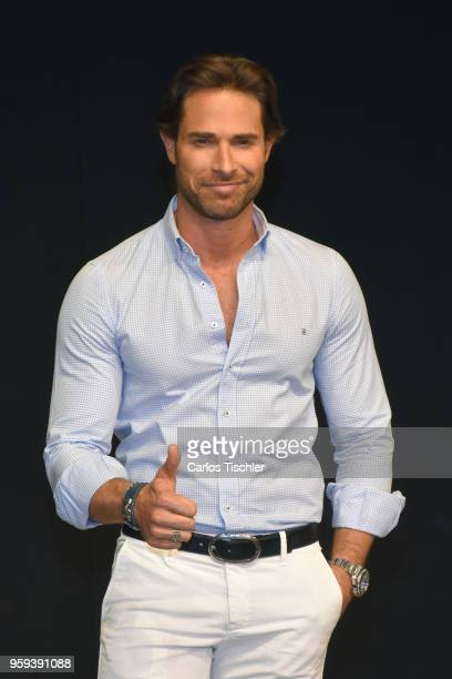 Sebastian Rulli poses for photos during a press conference to promote Una Pareja de Tres at 11 de Julio Theatre on May 15 2018 in Mexico City Mexico