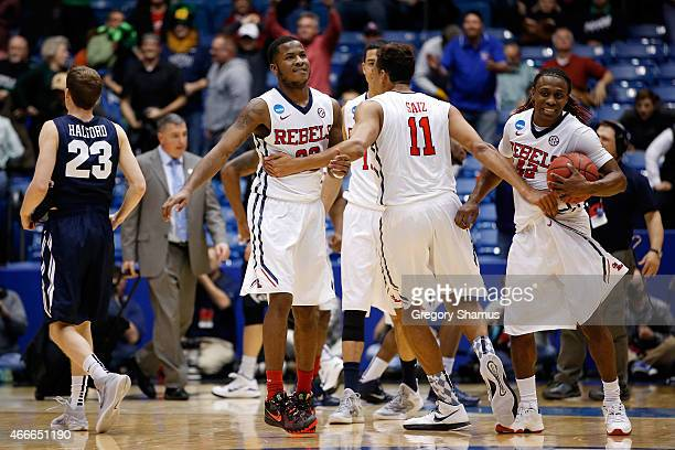 Sebastian Saiz of the Mississippi Rebels celebrates with his teammates after defeating the Brigham Young Cougars 94-90 in the first round of the 2015...