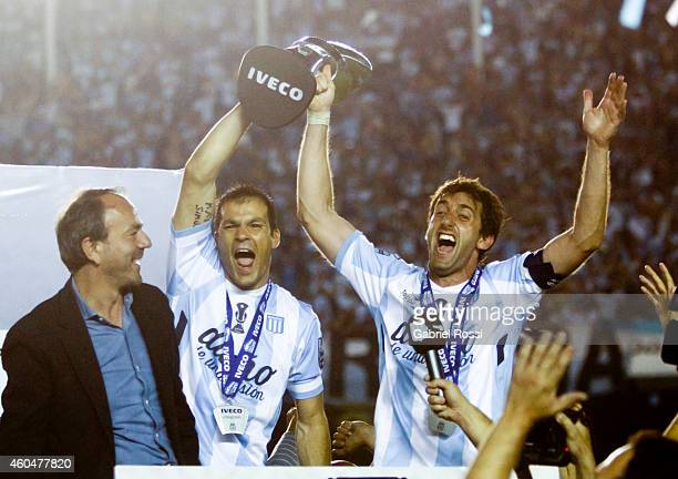 Sebastian Saja and Diego Milito of Racing Club celebrate the championship holding the trophy after winning a match between Racing Club and Godoy Cruz...