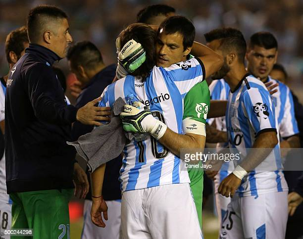 Sebastian Saja goalkeeper of Racing Club celebrates with teammate Oscar Romero at the end of a second leg match between Independiente and Racing Club...