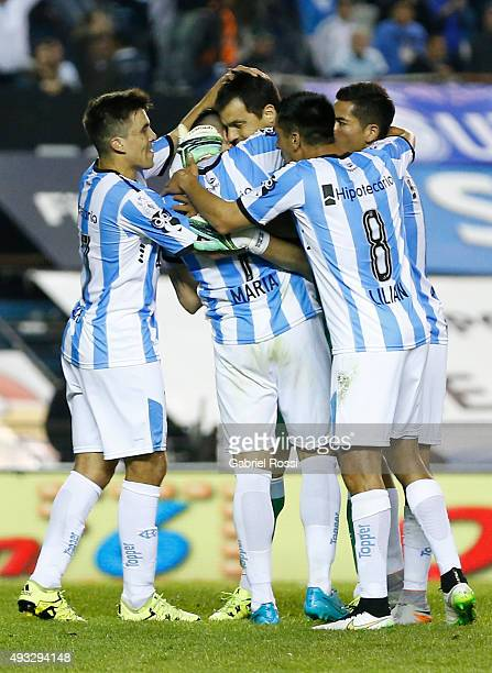 Sebastian Saja of Racing Club and teammates celebrate their team's third goal by a penalty kick during a match between Racing Club and Boca Juniors...