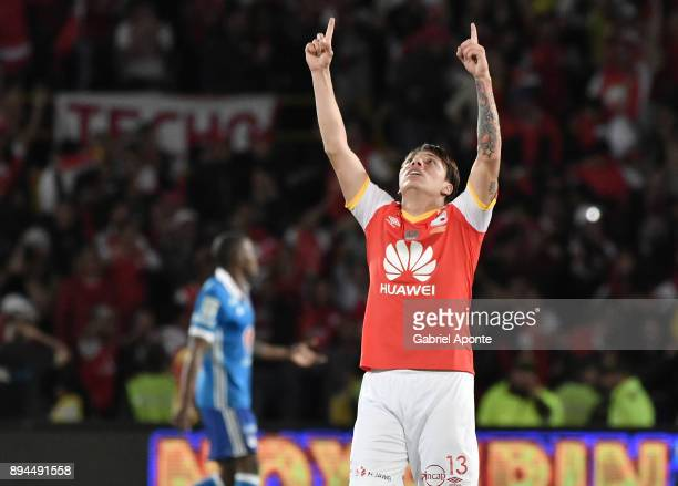 Sebastian Salazar of Santa Fe celebrates after the second goal of his team scored by his teammate Wilson Morelo during the second leg match between...