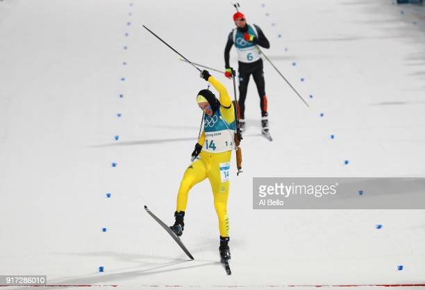 Sebastian Samuelsson of Sweden celebrates after crossing the finish line for the silver medal ahead of Benedikt Doll of Germany during the Men's...
