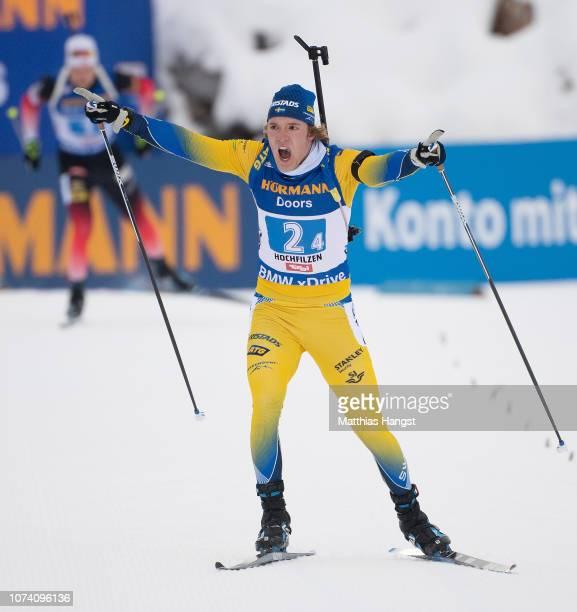 Sebastian Samuelsson of Sweden celebrates winning the IBU Biathlon World Cup Men's 4x7.5 km Relay on December 16, 2018 in Hochfilzen, Austria.