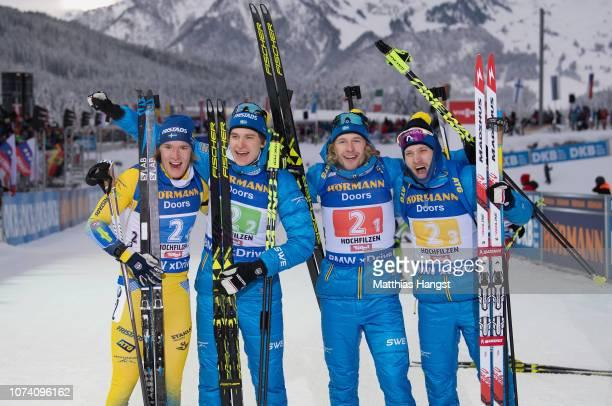 Sebastian Samuelsson Torstein Stenersen Martin Ponsiluoma and Peppe Femling of Sweden celebrate winning the IBU Biathlon World Cup Men's 4x75 km...
