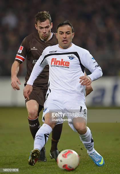 Sebastian Schachten of Pauli is challenged by Mahir Saglik of Paderborn during the second Bundesliga match between FC St Pauli and SC Paderborn 07 at...