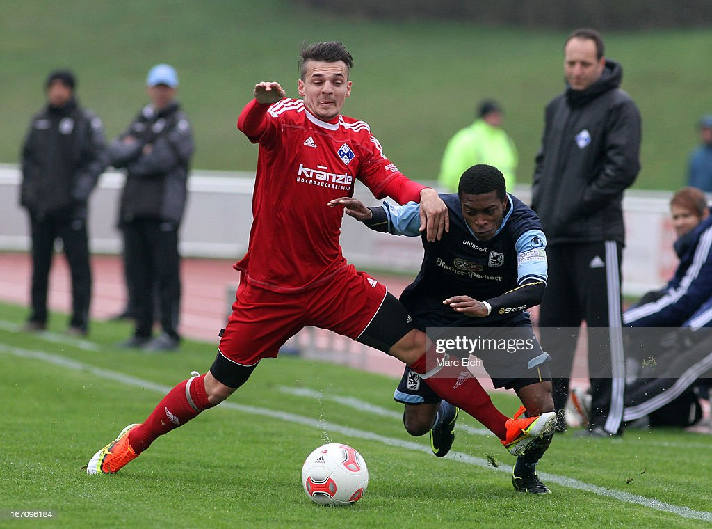 Sebastian Schaller of Illertissen (L) challenges Kodjovi Koussou of Muenchen (R) during the Regionalliga Bayern match between FV Illertissen and 1860 Muenchen II at Voehlinstadion on April 20, 2013 in Illertissen, Germany.