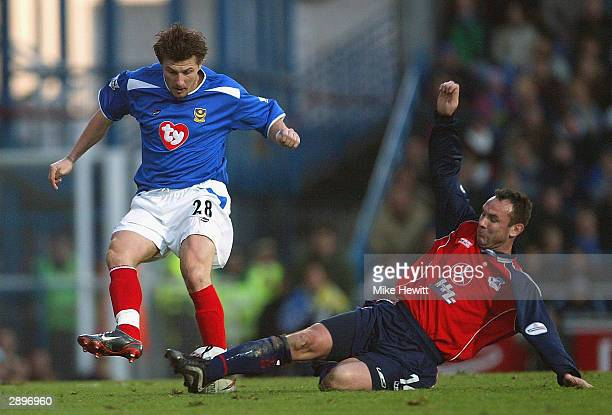 Sebastian Schemmel of Portsmouth is tackled by Peter Beagrie of Scunthorpe during the FA Cup Fourth Round match between Portsmouth and Scunthorpe...