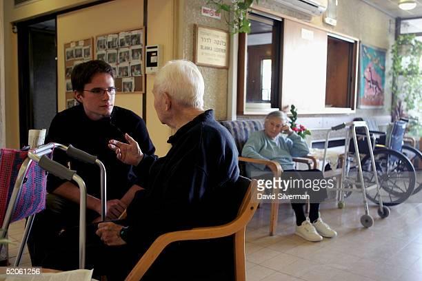Sebastian Schirrmeister a 20yearold German volunteer from Berlin sits with elderly Jewish Holocaust survivor Dr Leo Kraus in a retirement home...