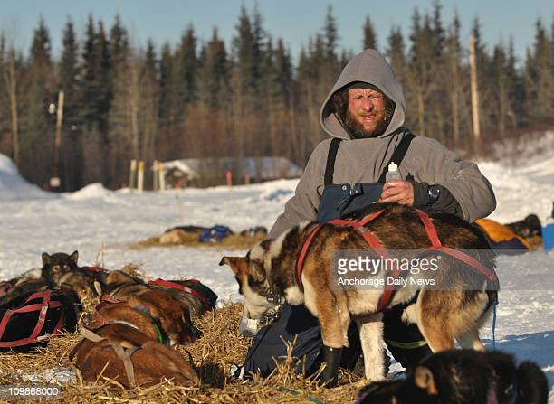 Sebastian Schnuelle from Whitehorse Yukon Territory works with his team at the Nikolai Alaska checkpoint during the Iditarod Trail Sled Dog Race on...