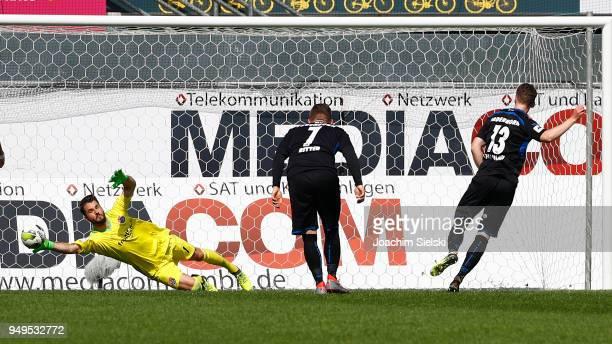 Sebastian Schonlau of Paderborn challenges Korbinian Mueller of Unterhaching and shoot the Goal 20 for Paderborn during the 3 Liga match between SC...