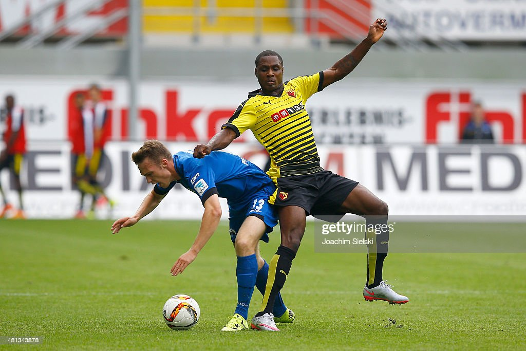 Sebastian Schonlau of Paderborn challenges Odion Ighalo of Watford during the pre-season friendly match between SC Paderborn and Watford FC at Benteler Arena on July 19, 2015 in Paderborn, Germany.