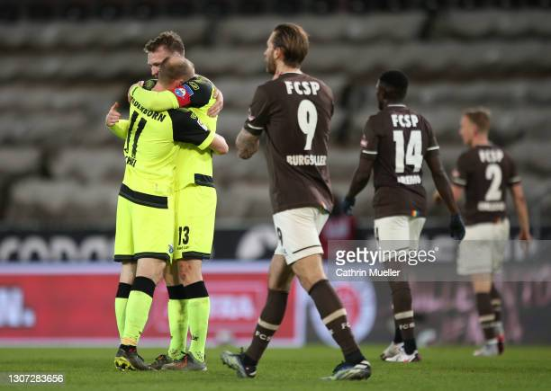 Sebastian Schonlau of SC Paderborn 07 celebrates with team mate Sven Michel after scoring their side's second goal during the Second Bundesliga match...