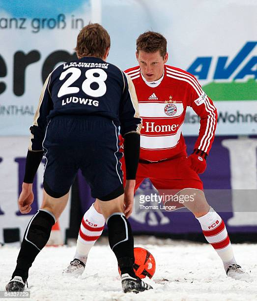 Sebastian Schweinsteiger of Munich and Michael Ludwig of Bamberg battle for the ball during the friendly match between FC Eintracht Bamberg and FC...