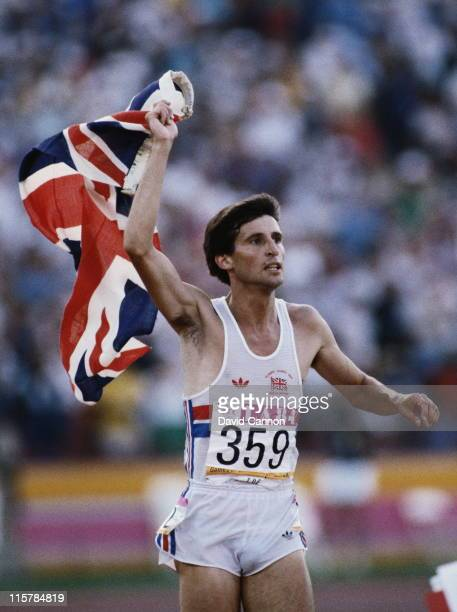 Sebastian Seb Coe of Great Britain celebrates with the Union Jack flag on the track after winning gold in the final of the Men's 1500 metres event at...